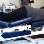 Chiropractic treatment table with person on it