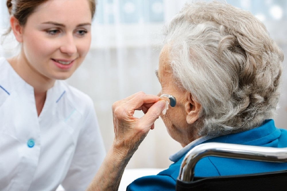 Hearing Health Professional checking ears