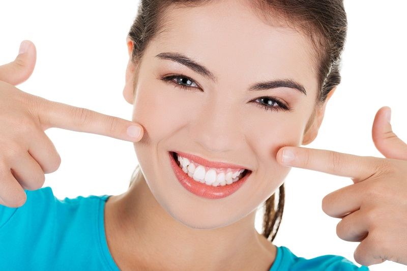 Invisalign Braces pointing to white teeth
