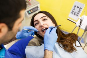 Root Canal Treatment woman in dentist chair