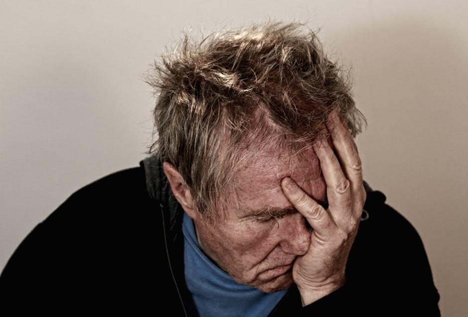 Chiropractic Treatment headache old man
