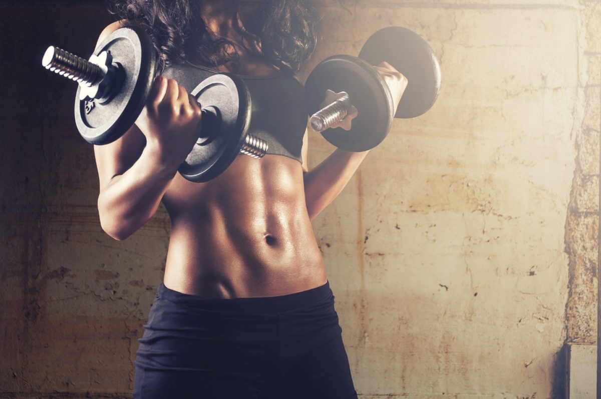 reach your fitness goals woman with dumbbells