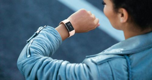 Are Fitness Trackers the Future of Health? checking watch