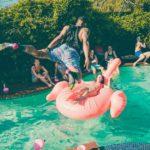 Summer Health Risks man jumping into pool water
