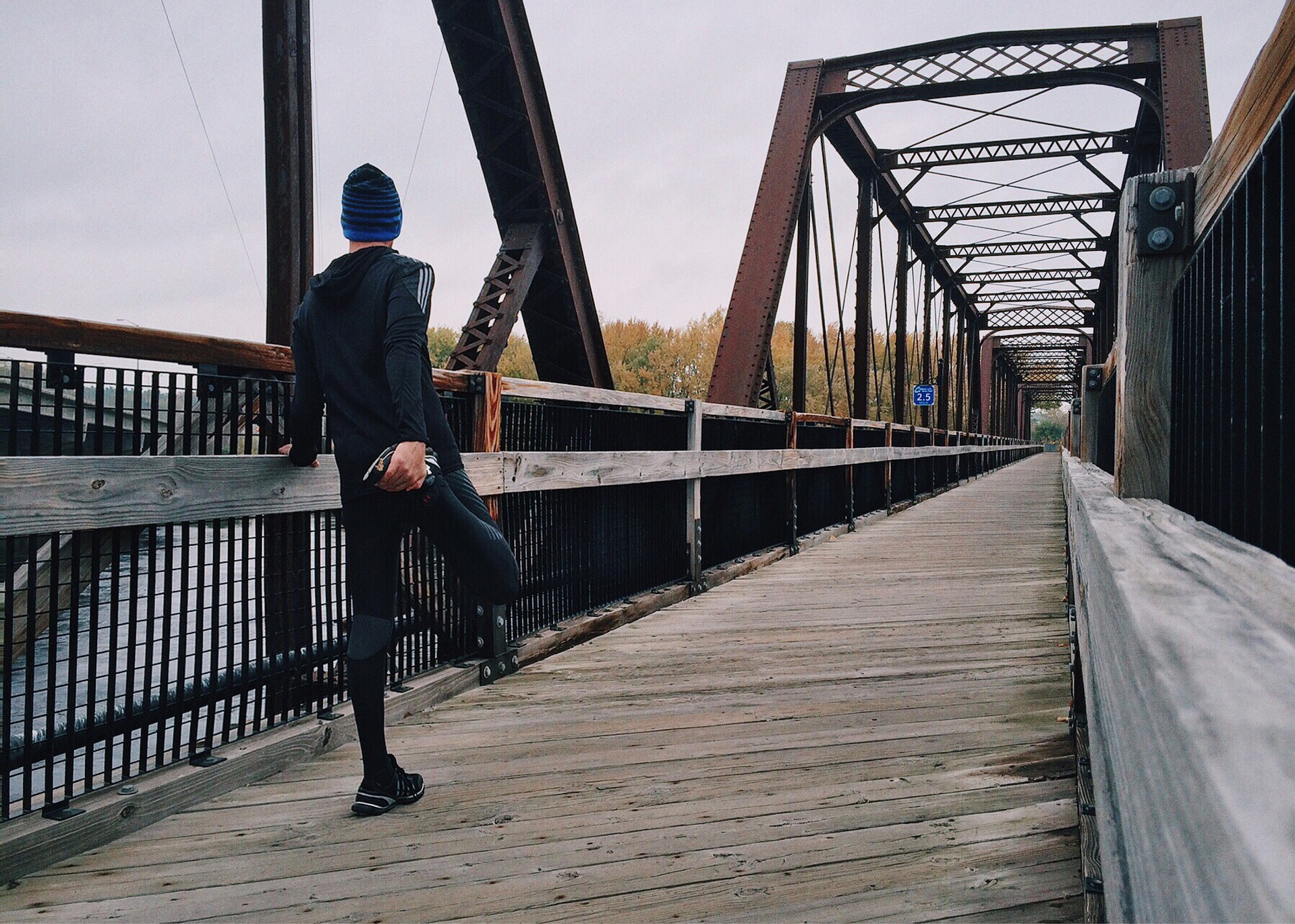 10K run stretching while on bridge