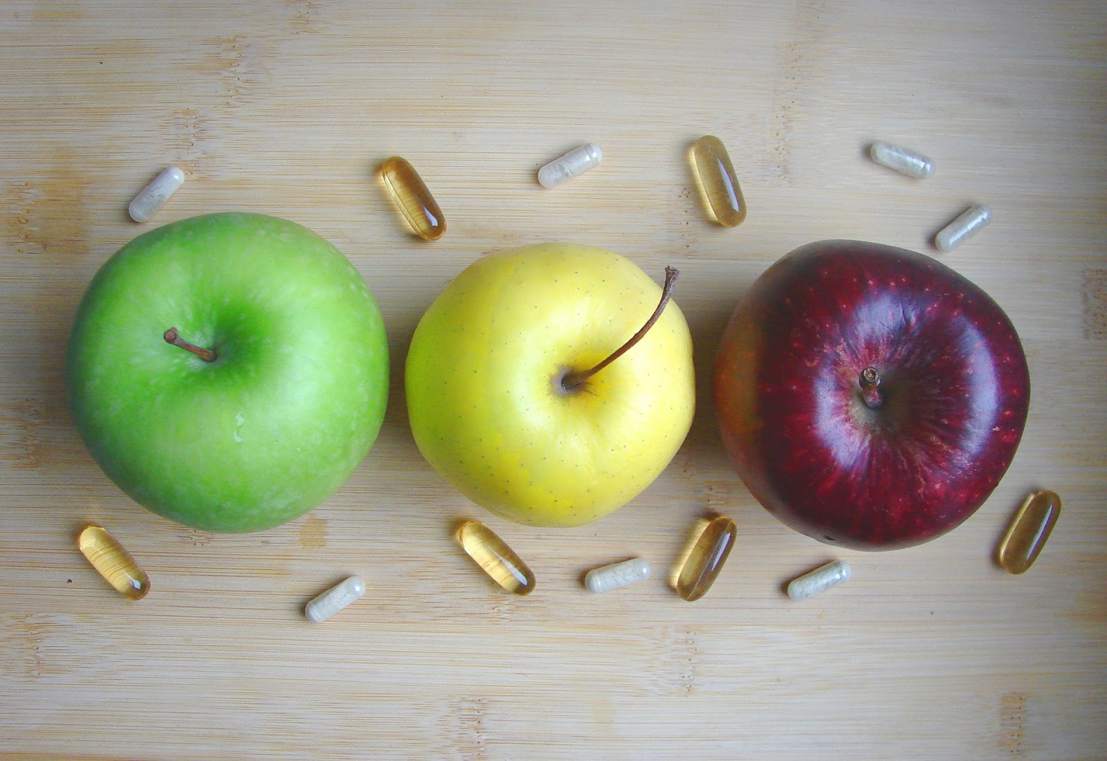 Supplements with apples on table