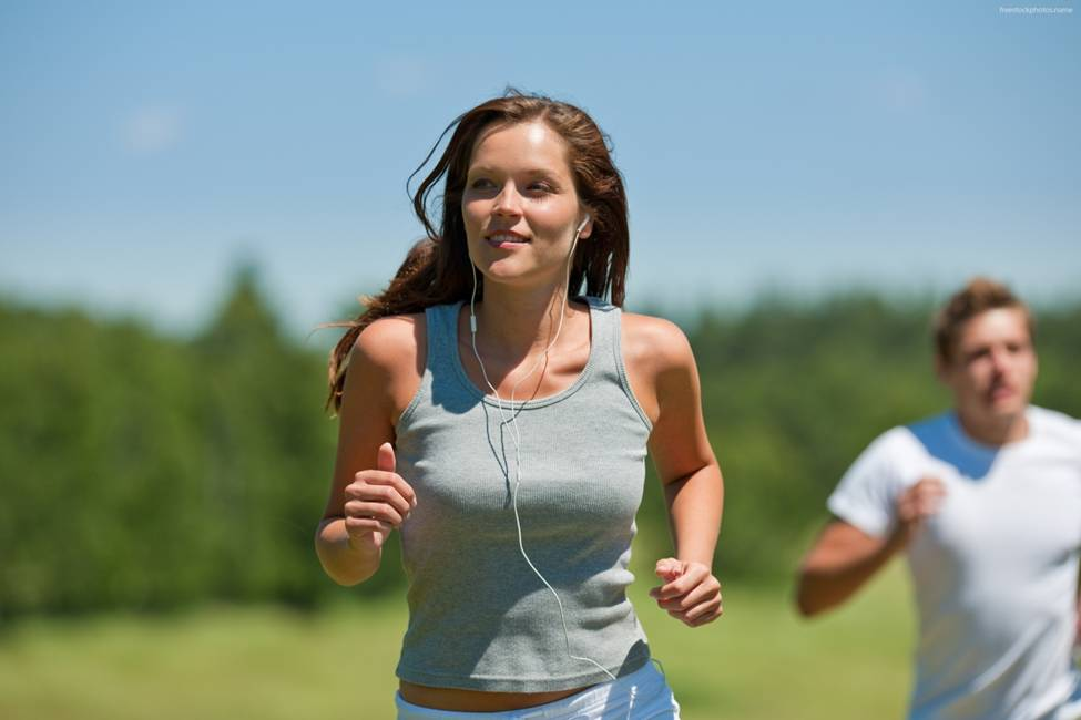 cardio woman running with earbuds