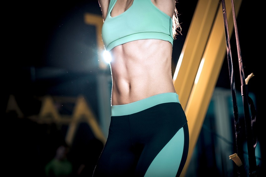 Lose Fat woman with six pack abs