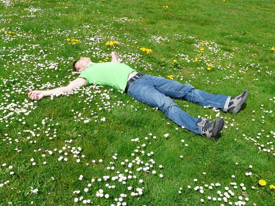 How To Save Your Health During Long Rides laying in grass