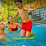 What is a Self-Cleaning Swim Spa? child swimming